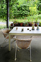 Exterior sitting area<br /> <br /> Artist Steve Miller spends his time between New York City and this old train station in the Hamptons, New York which was converted into a living space and 3000 sq. ft art studio.