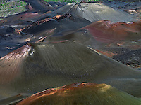 Massive and colorful cinder cones in the crater of HALEAKALA NATIONAL PARK on Maui in Hawaii are essence of its ambiance