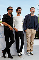 """CANNES, FRANCE - JULY 17: Nicolas Bedos, Pierre Niney and Jean Dujardin at photocall for the film """"OSS 117 : Alerte Rouge en Afrique Noire"""" (OSS 117 : From Africa With Love) at the 74th annual Cannes Film Festival in Cannes, France on July 17, 2021 <br /> CAP/GOL<br /> ©GOL/Capital Pictures"""