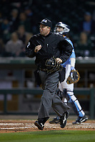 Home plate umpire John Kennedy jogs down the third base line during the game between the North Carolina Tar Heels and the Charlotte 49ers at BB&T BallPark on March 27, 2018 in Charlotte, North Carolina. The Tar Heels defeated the 49ers 14-2. (Brian Westerholt/Four Seam Images)