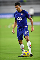 ORLANDO CITY, FL - JANUARY 31: Antonee Robinson #12 of the United States warming up before a game between Trinidad and Tobago and USMNT at Exploria stadium on January 31, 2021 in Orlando City, Florida.