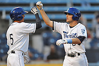 Asheville Tourists Kyle Parker #8 is congratulated after hitting a home run during a game against the Savannah Sand Gnats at McCormick Field in Asheville,  North Carolina;  June 6, 2011.  The Tourists won the game 10-1.  Photo By Tony Farlow/Four Seam Images