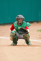 Fort Wayne TinCaps catcher Dane Phillips (9) warms up his pitcher in the bullpen prior to the game against the Lansing Lugnuts at Cooley Law School Stadium on June 5, 2013 in Lansing, Michigan.  The TinCaps defeated the Lugnuts 8-5.  (Brian Westerholt/Four Seam Images)