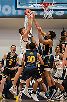 WASHINGTON, DC - FEBRUARY 22: Chase Paar #3 of George Washington and Ed Croswell #11 of La Salle battle under the basket during a game between La Salle and George Washington at Charles E Smith Center on February 22, 2020 in Washington, DC.