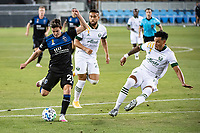 SAN JOSE, CA - SEPTEMBER 19: Carlos Fierro #21 of the San Jose Earthquakes and Julio Cascante #18 of the Portland Timbers during a game between Portland Timbers and San Jose Earthquakes at Earthquakes Stadium on September 19, 2020 in San Jose, California.