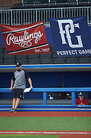 The coach of Team Red watches from in front of the dugout during the Atlantic Coast Prospect Showcase hosted by Perfect Game at Truist Point on August 22, 2020 in High Point, NC. (Brian Westerholt/Four Seam Images)