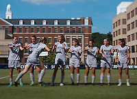 Mary Kroening (21) of Georgetown gives her teammates a high five as she's introduced before the game at Shaw Field on the campus of Georgetown University in Washington, DC.  Georgetown tied DePaul, 1-1, in double overtime.