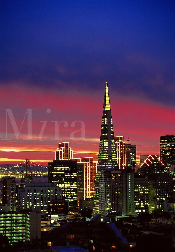 Skyline at sunrise with Bay Bridge beyond San Francisco California USA