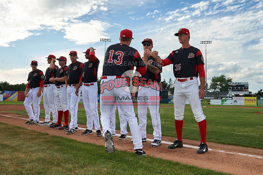 Batavia Muckdogs Travis Neubeck (13) fist bumps Marcus Crescentini (44) and Connor Bach (35) during introductions before a game against the State College Spikes on June 22, 2016 at Dwyer Stadium in Batavia, New York.  State College defeated Batavia 11-1.  (Mike Janes/Four Seam Images)