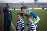 Greenock Morton 2 Stranraer 0, 21/02/2015. Cappielow Park, Greenock. Home team forward Declan McManus poses for a photograph with two young mascots on the pitch before Greenock Morton take on Stranraer in a Scottish League One match at Cappielow Park, Greenock. The match was between the top two teams in Scotland's third tier, with Morton winning by two goals to nil. The attendance was 1,921, above average for Morton's games during the 2014-15 season so far. Photo by Colin McPherson.