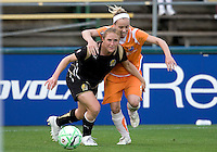 03 May 2009: Rachel Buehler of the FC Gold Pride controls the ball away from Kelly Parker of the Sky Blue during the game at Buck Shaw Stadium in Santa Clara, California.   FC Gold Pride defeated Sky Blue FC, 1-0.