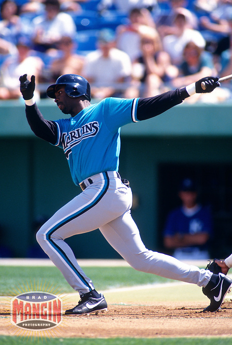 WINTER HAVEN, FL - Devon White of the Florida Marlins in action during a spring training game against the Cleveland Indians at Chain-O-Lakes Park in Winter Haven. Florida in 1996. Photo by Brad Mangin