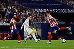 Thomas Lemar (L) and Angel Martin Correa (R) of Atletico de Madrid and XXX of Real Madrid during La Liga match between Atletico de Madrid and Real Madrid at Wanda Metropolitano Stadium in Madrid, Spain. September 28, 2019. (ALTERPHOTOS/A. Perez Meca)