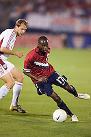 USA's (17) DaMarcus Beasley is defended by Latvia's (8) Viktors Morozs. USA defeated Latvia 1-0 in an international friendly at Rentschler Field, East Hartford, CT, on May 28, 2006.