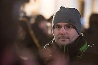 """Etwa 200 Anhaenger des Berliner Ablegers rechten Pegida-Bewegung, Baergida, versammelten sich am Montag den 12. Januar 2015 in Berlin vor dem Brandenburger Tor zu einer Demonstration gegen eine angebliche Islamisierung Deutschlands.<br /> Unter den Anhaengern von Baergida waren viele bekannte militante Neonazis, der NPD und Hooligans sowie Mitglieder der Rechtsparteien AfD und Pro Deutschland und der rechtsradikalen German Defense League. Teilnehmer der Veranstaltung bruellten wiederholt """"Wir sind das Volk"""" und """"Luegenpresse, auf die Fresse"""" und hielten Schilder mit der Aufschrift """"Je suis Charlie"""".<br /> Im Bild: Sebastian Schmidtke, Berliner NPD-Landesvorsitzende.<br /> 12.1.2015, Berlin<br /> Copyright: Christian-Ditsch.de<br /> [Inhaltsveraendernde Manipulation des Fotos nur nach ausdruecklicher Genehmigung des Fotografen. Vereinbarungen ueber Abtretung von Persoenlichkeitsrechten/Model Release der abgebildeten Person/Personen liegen nicht vor. NO MODEL RELEASE! Nur fuer Redaktionelle Zwecke. Don't publish without copyright Christian-Ditsch.de, Veroeffentlichung nur mit Fotografennennung, sowie gegen Honorar, MwSt. und Beleg. Konto: I N G - D i B a, IBAN DE58500105175400192269, BIC INGDDEFFXXX, Kontakt: post@christian-ditsch.de<br /> Bei der Bearbeitung der Dateiinformationen darf die Urheberkennzeichnung in den EXIF- und  IPTC-Daten nicht entfernt werden, diese sind in digitalen Medien nach §95c UrhG rechtlich geschuetzt. Der Urhebervermerk wird gemaess §13 UrhG verlangt.]"""