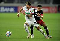 WASHINGTON, DC - JULY 7: Leonel Moreira Ledezma #23 of Liga Deportiva Alajuense battles for the ball with Allexon Saravia #51 of D.C. United during a game between Liga Deportiva Alajuense  and D.C. United at Audi Field on July 7, 2021 in Washington, DC.