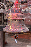 Nepal, Patan.  Temple Bell, with Offering Remnants of Kumkuma (Sindoor) Powder.