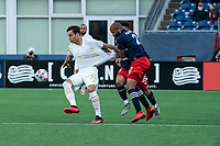 FOXBOROUGH, MA - MAY 1: Erick Torres #31 Forward of Atlanta United FC breaking away from Andrew Farrell #2 of New England Revolution during a game between Atlanta United FC and New England Revolution at Gillette Stadium on May 1, 2021 in Foxborough, Massachusetts.