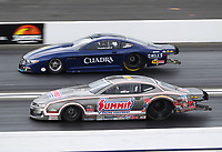 Feb 9, 2020; Pomona, CA, USA; NHRA pro stock driver Jason Line (near) races alongside Fernando Cuadra Jr during the Winternationals at Auto Club Raceway at Pomona. Mandatory Credit: Mark J. Rebilas-USA TODAY Sports