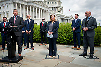 GOP Conference Chairwoman Liz Cheney (R-WY, center) stands in her taped off safe distancing square and listens while House Minority Leader Rep. Kevin McCarthy (R-Calif., left) holds a media availability to announce that Republican leaders have filed a lawsuit against House Speaker Nancy Pelosi and congressional officials in an effort to block the House of Representatives from using a proxy voting system to allow for remote voting during the coronavirus pandemic, outside of the U.S. Capitol in Washington, DC., Wednesday, May 27, 2020. Credit: Rod Lamkey / CNP/AdMedia