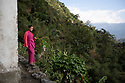 India - Sikkim - A Lepcha girl stands on top of a hill overlooking the majestous mountains in the village of Keshel located two hours walk from the nearest unpaved road.
