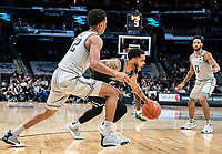 WASHINGTON, DC - FEBRUARY 19: Luwane Pipkins #12 of Providence pushes away from Terrell Allen #12 of Georgetown during a game between Providence and Georgetown at Capital One Arena on February 19, 2020 in Washington, DC.