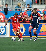 23 May 09: New England Revolution midfielder Chris Tierney #8 and Toronto FC midfielder Dewayne DeRosario #14 in action during a game between the New England Revolution and Toronto FC..Toronto FC won 3-1.
