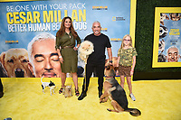 """LOS ANGELES - JULY 30: Alex Meneses and Cesar Millan attend the premiere event for National Geographic's """"Cesar Millan: Better Human, Better Dog"""" at the Westfield Century City Mall Atrium on July 30, 2021 in Los Angeles, California. (Photo by Stewart Cook/National Geographic/PictureGroup)"""