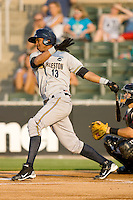 Jimmy Paredes #13 of the Charleston RiverDogs follows through on his swing against the Kannapolis Intimidators at Fieldcrest Cannon Stadium May 29, 2010, in Kannapolis, North Carolina.  Photo by Brian Westerholt / Four Seam Images