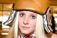"""Hisa Nagi, cos-playing as Pritsuko Kubel Kettenkrad, at the 12th annual Katsucon, a convention for fans of Japanese comics, animation (anime), and video games, held in Washington D.C. on February 18, 2006 and attended by over 8,000 people.<br /> <br /> Cosplay, short for """"costume play"""", is the act of creating and wearing outfits of one's favorite anime, comic, or video game and often acting out that characters actions."""