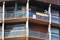 15th September 2020; Lyon, France; Tour De France 2020, La Tour-du-Pin to Villard-de-Lans, stage 16; A cycling fan keeps an eye on action from his hotel balcony