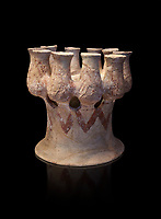Cycladic Kernos a multiple vessel in a base.  Early Cycladic III (2300-2000 BC) , Phylakopi, Melos. National Archaeological Museum Athens. Cat No 5829. Black background.<br /> <br /> <br /> This complex vessel was used for ritual offerings. During this period pottery was plainer with simple geometric decorations. Depicts of birds or lowers were rare.
