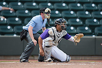 Winston-Salem Dash catcher Daniel Gonzalez (13) sets a target as home plate umpire Austin Jones looks on during the game against the Buies Creek Astros at BB&T Ballpark on April 16, 2017 in Winston-Salem, North Carolina.  The Dash defeated the Astros 6-2.  (Brian Westerholt/Four Seam Images)
