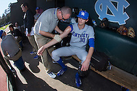 Kentucky Wildcats starting pitcher Sean Hjelle (30) gets his arm rubbed down by the trainer prior to the game against the North Carolina Tar Heels at Boshmer Stadium on February 17, 2017 in Chapel Hill, North Carolina.  The Tar Heels defeated the Wildcats 3-1.  (Brian Westerholt/Four Seam Images)