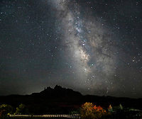 The Milky Way appears in the night sky over Eagle Crags at Zion National Park, Utah