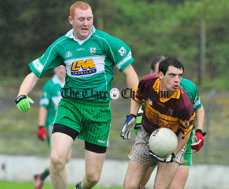 Miltown's Dessie Mullin drives forward pursued Patsy Keyes of Wolfe Tones. Photograph by Declan Monaghan