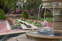Fountain with rills edged by brick paths and flower beds with tulips, Norfolk Botanical Garden