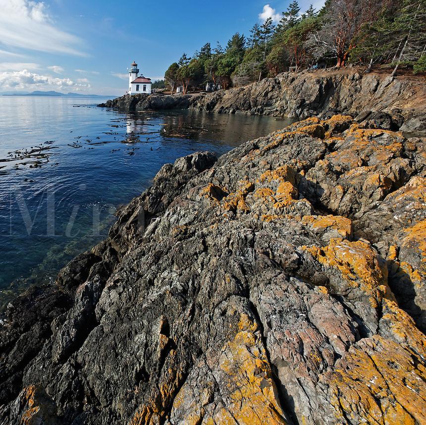 Lime Kiln Lighthouse and rocky shoreline, Lime Kiln Point State Park, San Juan Island, Washington