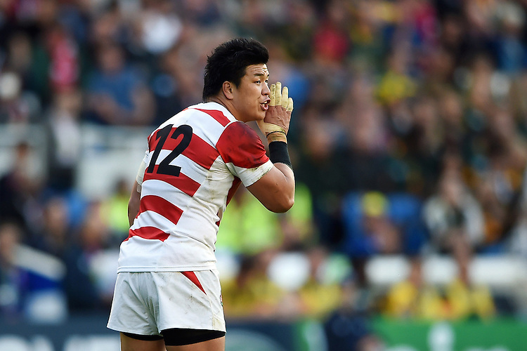 Harumichi Tatekawa of Japan has a word with his backline. Rugby World Cup Pool B match between South Africa and Japan on September 19, 2015 at the Brighton Community Stadium in Brighton, England. Photo by: Patrick Khachfe / Stewart Communications