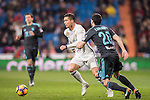 Cristiano Ronaldo (l) of Real Madrid competes for the ball with Joseba Zaldua Bengoechea of Real Sociedad during their La Liga match between Real Madrid and Real Sociedad at the Santiago Bernabeu Stadium on 29 January 2017 in Madrid, Spain. Photo by Diego Gonzalez Souto / Power Sport Images