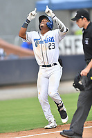 Asheville Tourists Zach Daniels (23) celebrates hitting a home run during a game against the Winston-Salem Dash on August 3, 2021 at McCormick Field in Asheville, NC. (Tony Farlow/Four Seam Images)