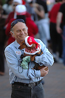 A member of the San Diego Dachshund Club waits with his dog before taking part in a parade across the stage at the Sprecklels Organ Pavillion in Balboa Park, Sunday December 23, 2007.