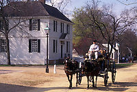 Colonial Williamsburg, VA, horse-drawn carriage, Williamsburg, Virginia, A team of horses pulling an open carriage carries tourists through the 18th century village of Colonial Williamsburg in Colonial Williamsburg Historic Area.