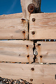 Hastings, England. Detail of wooden groyne sea defences with rusty nails.
