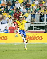 Portugal defender Bruno Alves (2) and Brazil forward Jo (21) compete for a head ball.  In an International friendly match Brazil defeated Portugal, 3-1, at Gillette Stadium on Sep 10, 2013.