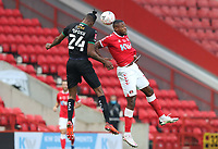 Jerome Opoku of Plymouth Argyle and Chuks Aneke of Charlton Athletic go up for a header during Charlton Athletic vs Plymouth Argyle, Emirates FA Cup Football at The Valley on 7th November 2020