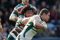 Calum Clark of Northampton Saints (right) is tackled by Logoviii Mulipola  of Leicester Tigers during the LV= Cup Final match between Leicester Tigers and Northampton Saints at Sixways Stadium, Worcester on Sunday 18 March 2012 (Photo by Rob Munro, Fotosports International)