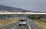 Thousands of mourners line the route through Washoe Valley as a procession travels to a memorial service for Carson City Sheriff's Deputy Carl Howell in Reno, Nev., on Thursday, Aug. 20, 2015. Howell was shot and killed early Saturday morning after responding to a domestic violence call. (Cathleen Allison/Las Vegas Review-Journal)