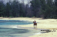 Woman on horseback at remote beach in Mokuleia, North Shore of Oahu