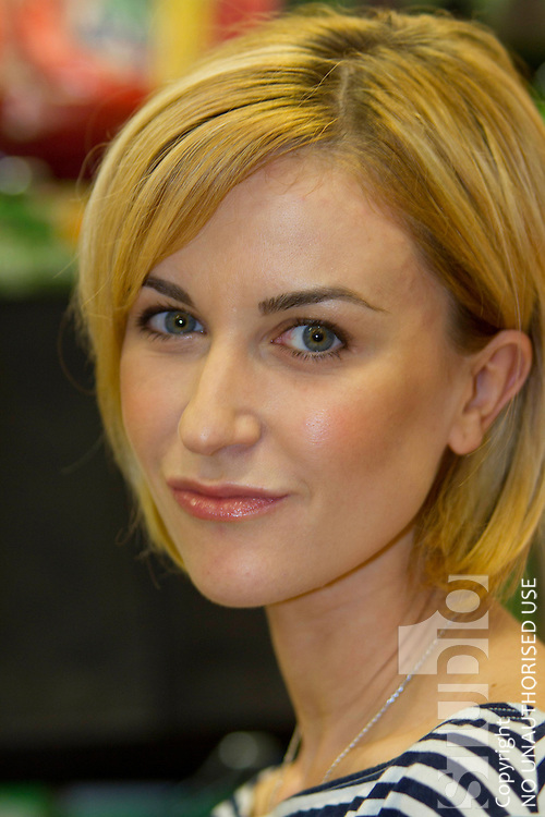 With no help, members of the Public Overpower Katherine Kelly and almost come to blows as she Opens New Poundland Store in Peterborough